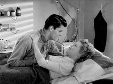 Keefe Brasselle as Guy Richards and Sally Forrest as Carol Williams in Ida Lupino's NEVER FEAR.