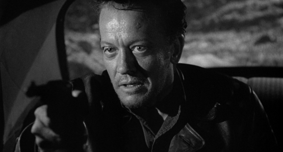 William Talman, as THE HITCH-HIKER, terrorizes everyone he encounters in the classic noir directed by Ida Lupino.